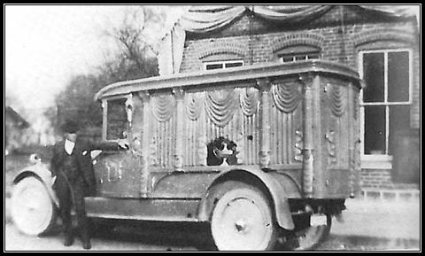 L.O. Wertenberger& his first motorized hearse in 1925  in front of Laketon Harware Store